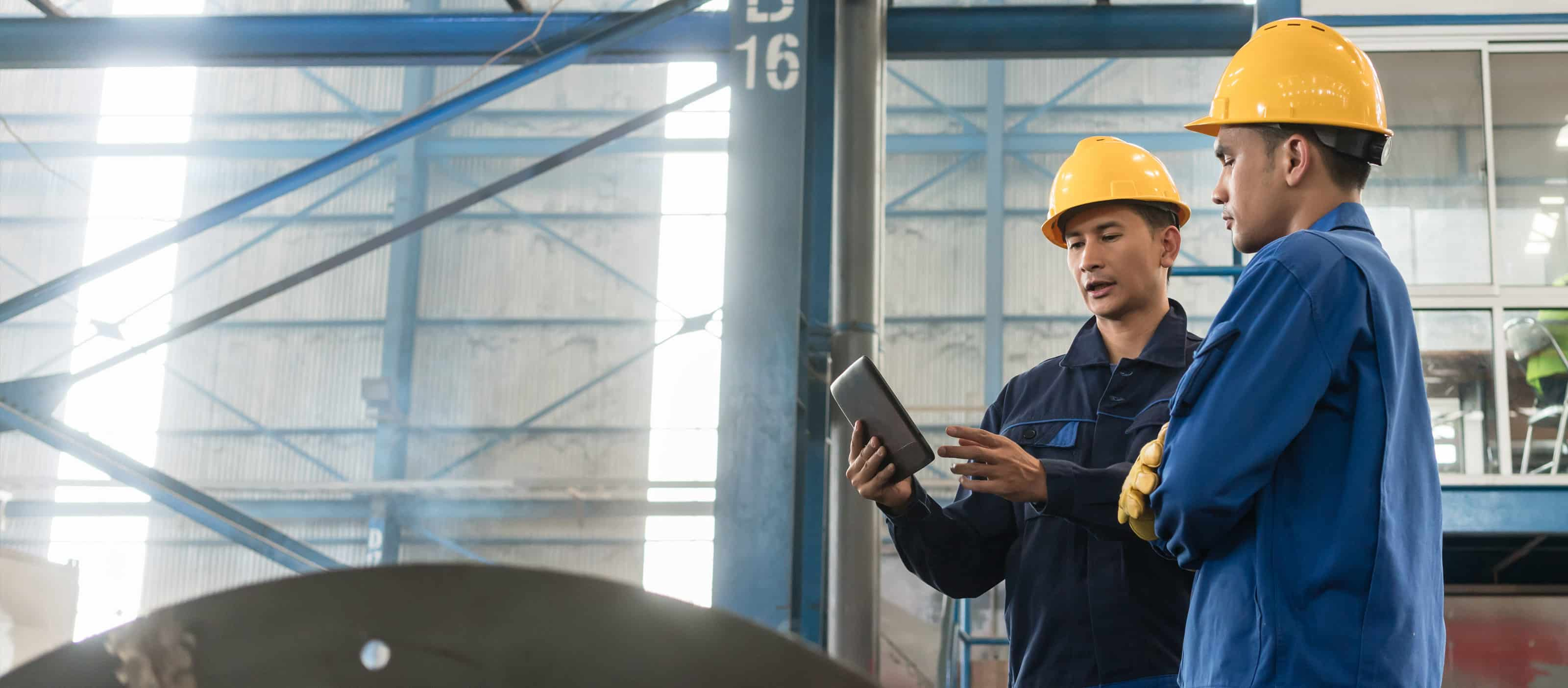 Engineers using GE Digital industrial software on mobile device