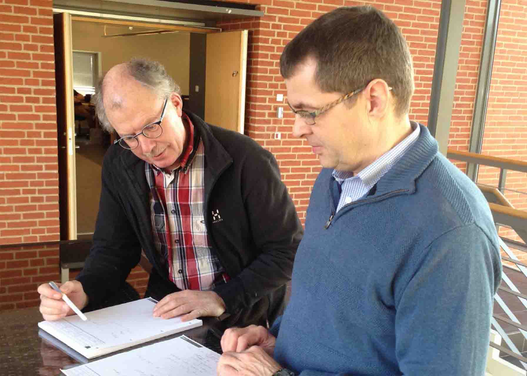 Jan Ravn and John Sorensen, Herning Vand, assess the collected information.