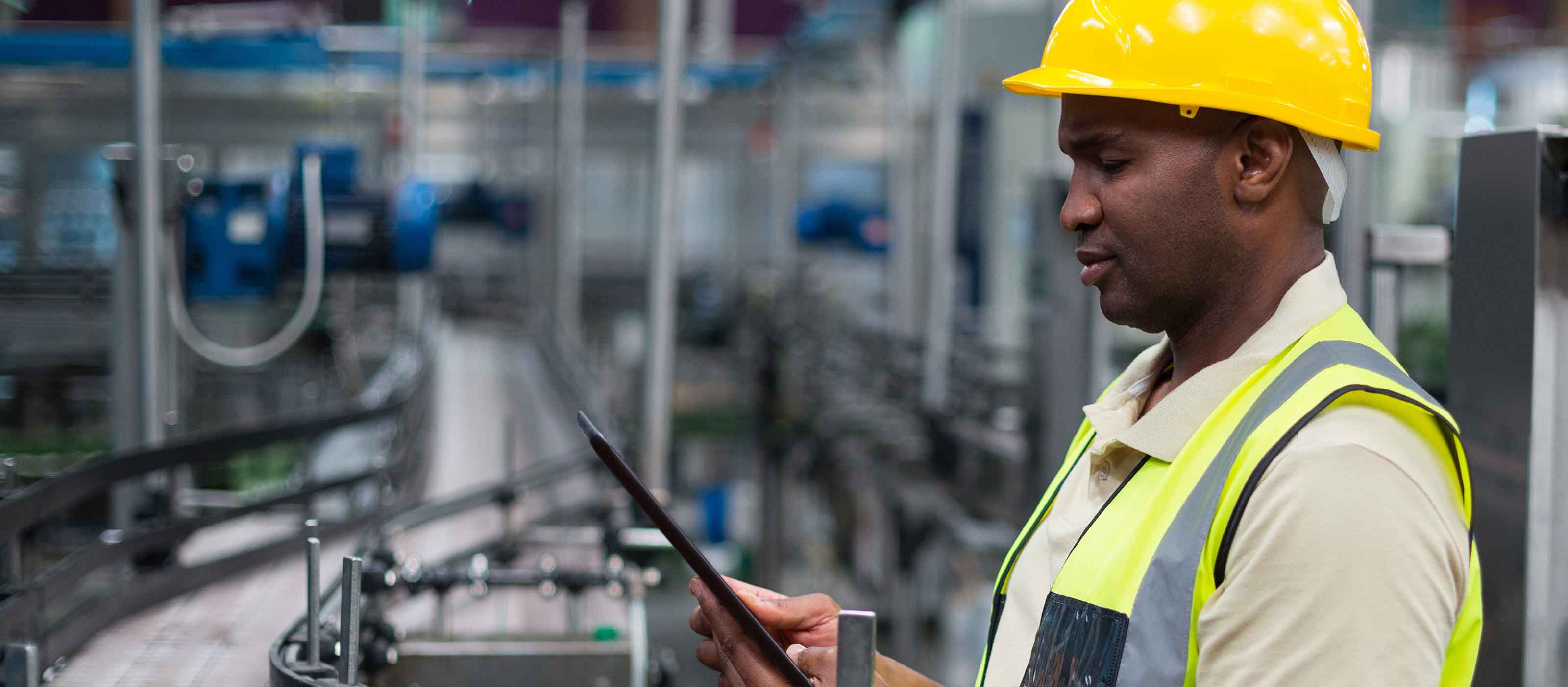 Factory engineer using GE Digital manufacturing automation software