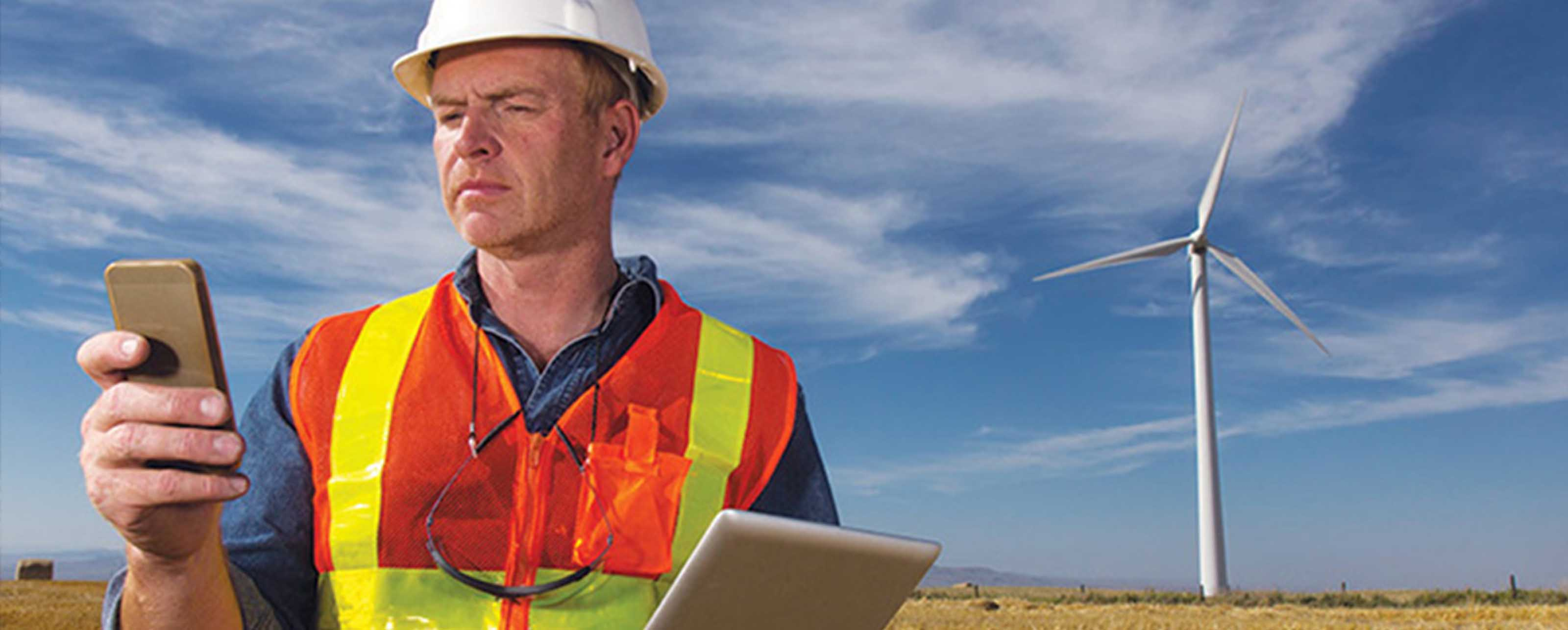 Utility engineer using GE Digital remote operations software for grid optimization