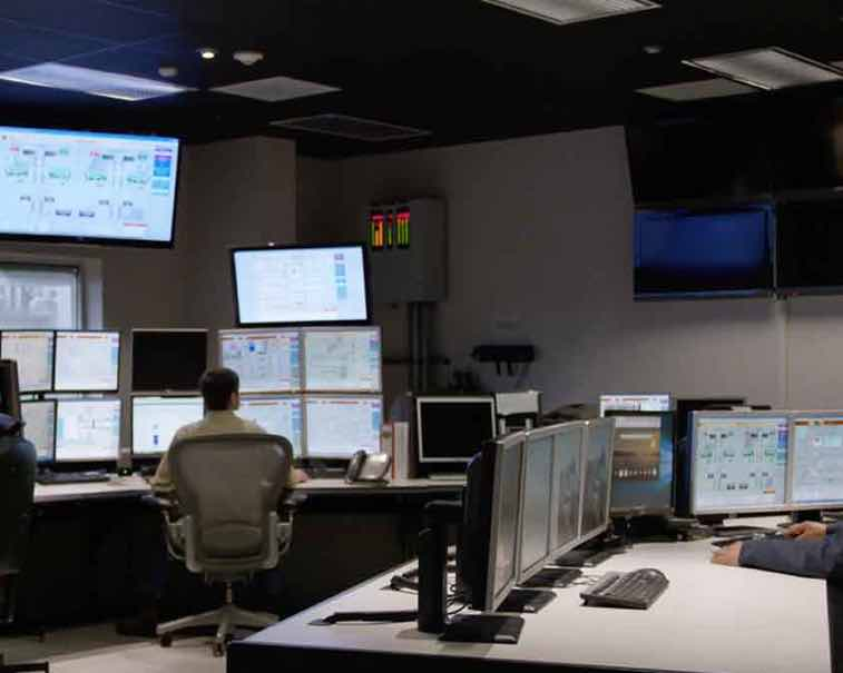 System Integrators using GE Digital software in an industrial control room