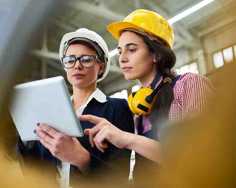 Two engineers comparing industrial information | GE Digital