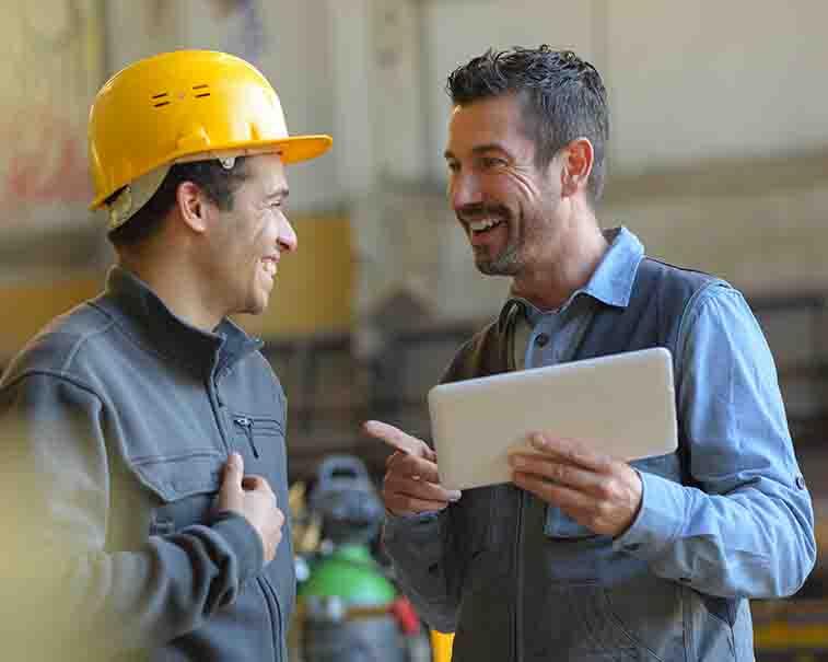 Engineers using GE Digital industrial software