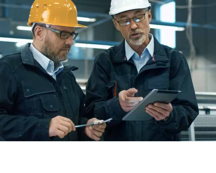 Engineers as digital workers using GE Digital industrial software on tablets