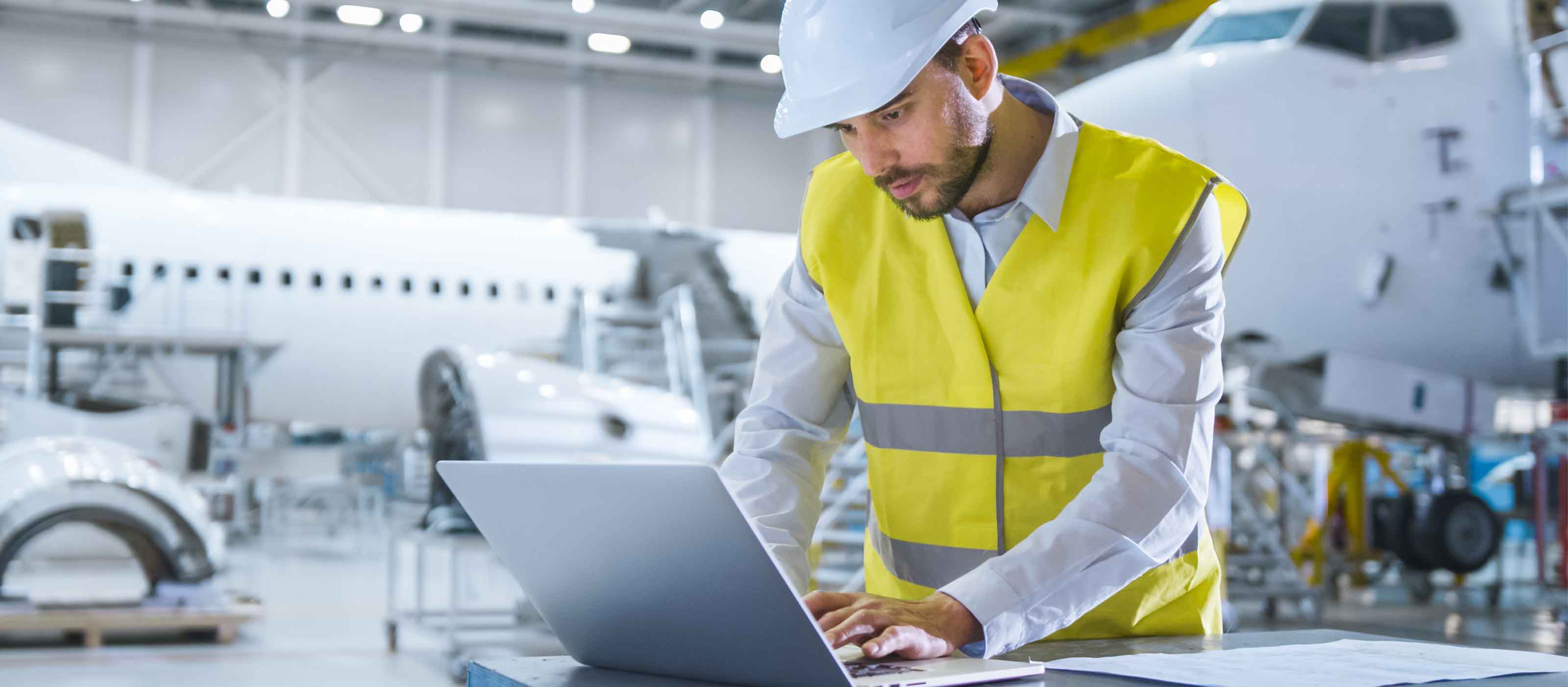 Aviation engineer using GE Digital software