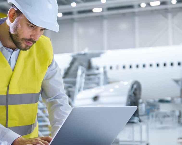 Aviation engineer using GE Digital software and emerging technologies