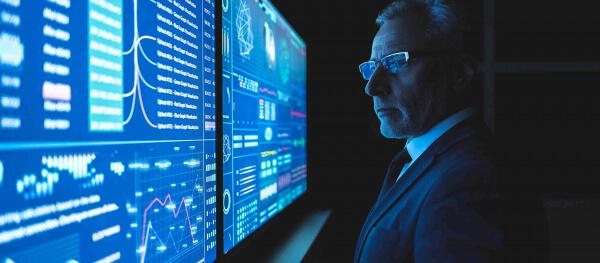 Industrial executive looking at analytics   Sensor Health software by GE Digital