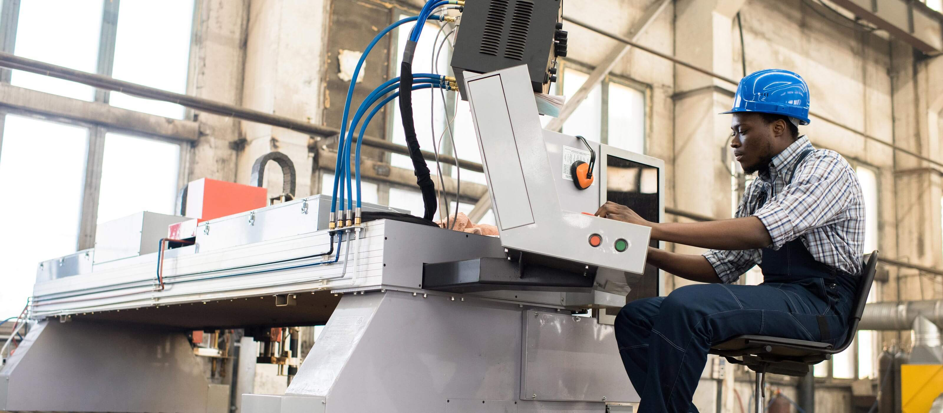 Engineer using HMI/SCADA software in manufacturing environment