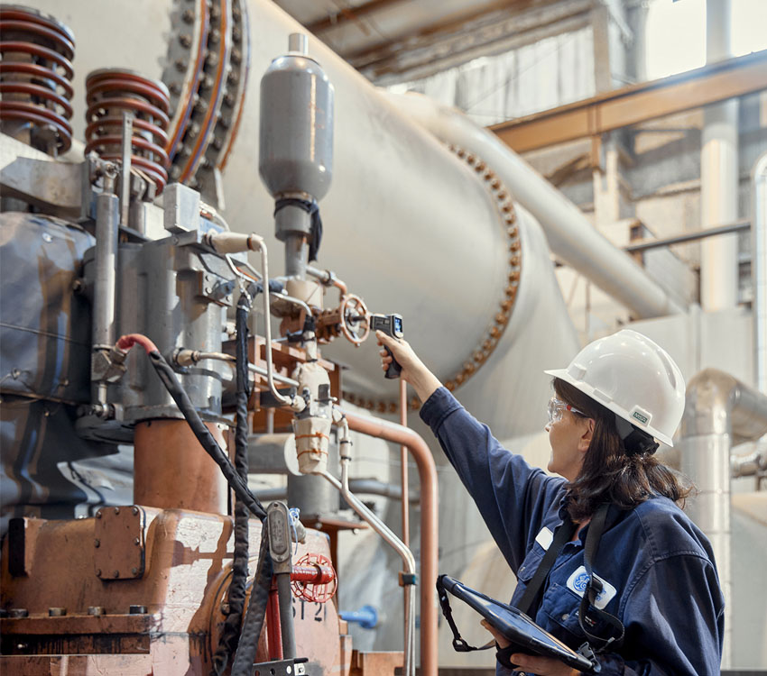 Engineer inspecting gas power generation plant using GE Digital software