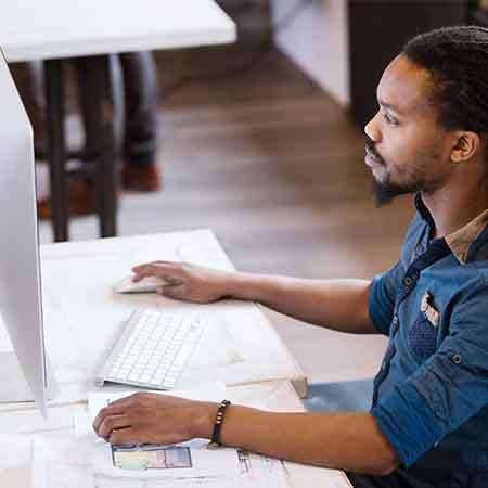 Engineer using GE Digital software