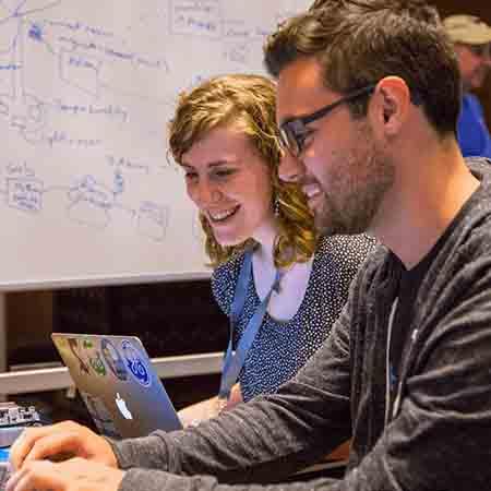 Engineers using GE Digital HMI/SCADA software