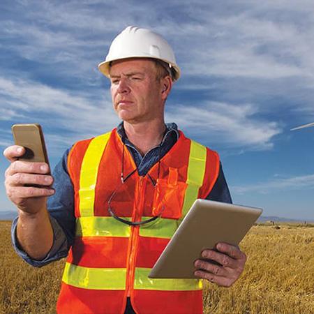 Utility engineer remote monitoring the energy grid using GE Digital grid modernization software