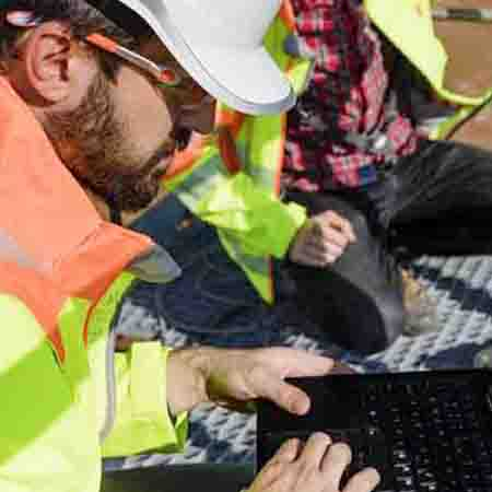 Engineers in the field using remote operations software from GE Digital