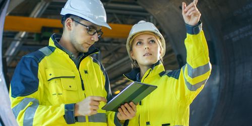 Engineers working on deployment and implementation of industrial applications