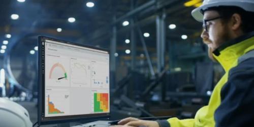 Engineer with GE Digital APM software for preventative maintenance
