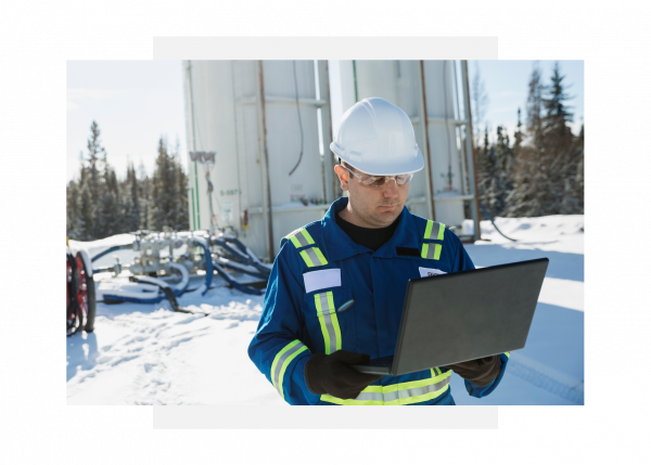 Industrial maintenance operator using GE Digital software on mobile device for APM