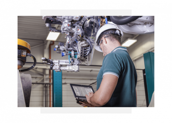 Engineer using GE Digital's Predix software to monitor industrial asset performance