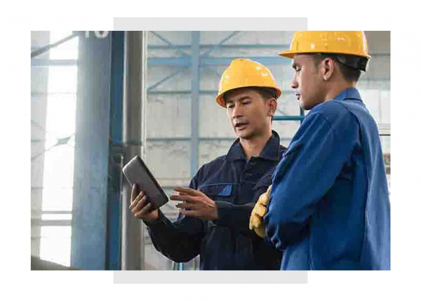 Industrial maintenance engineers using GE Digital software