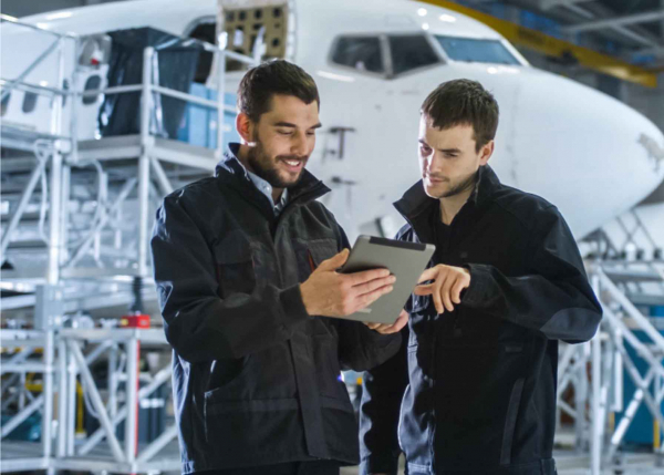 Aviation engineers working together for predictive maintenance using GE Digital solutions