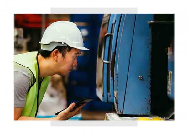 Industrial maintenance engineers using GE Digital software