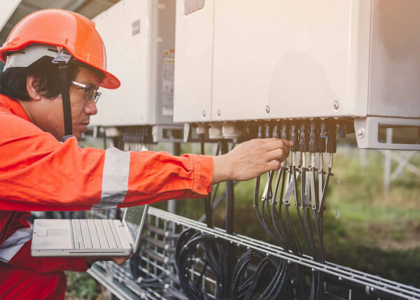 Utility worker using GE Digital remote access software