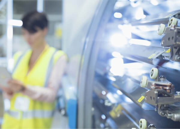 Manufacturing worker using GE Digital Automation software