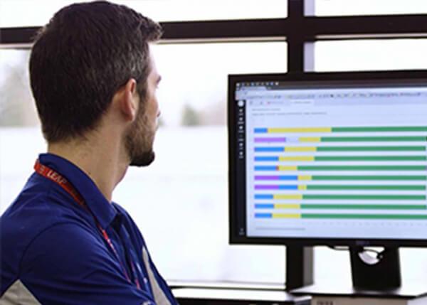 Engineer using GE Digital APM software to monitor industrial asset performanceEngineer using GE Digital APM software to monitor industrial asset performance