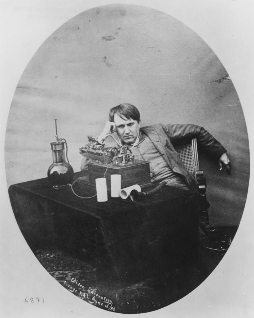 Edison listening to his wax cylinder phonograph 1888