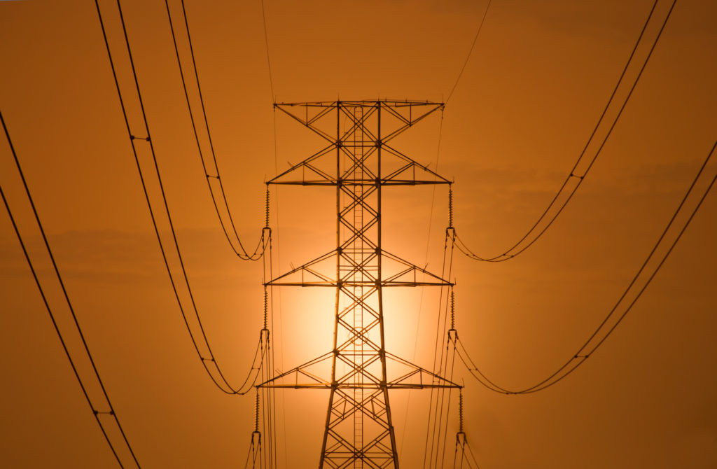 The silhouette of high voltage tower at dawn