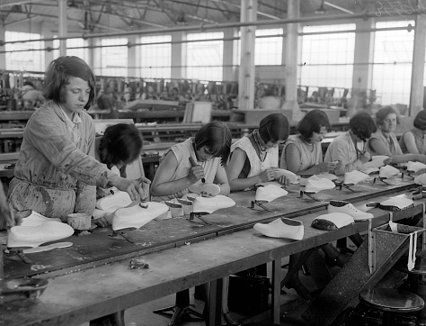 (A production line at Dunlop's rubber shoe factory in Liverpool. Courtesy Getty Images.)