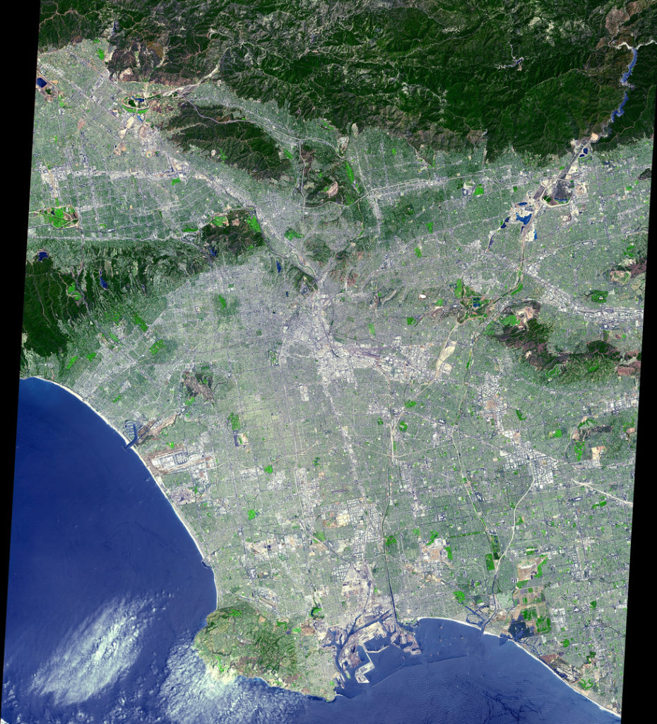 """The data were processed to create a simulated natural color image. From its start as a sleepy Spanish pueblo in 1781, Los Angeles and its metropolitan area has grown to become an ethnically diverse, semitropical megalopolis, laying claim as the principal center of the western United States and the nation's second largest urban area. The city's economy is based on international trade, aerospace, agriculture, tourism, and filmmaking. Los Angeles provides a glimpse of the typically cosmopolitan and global city of the future."""