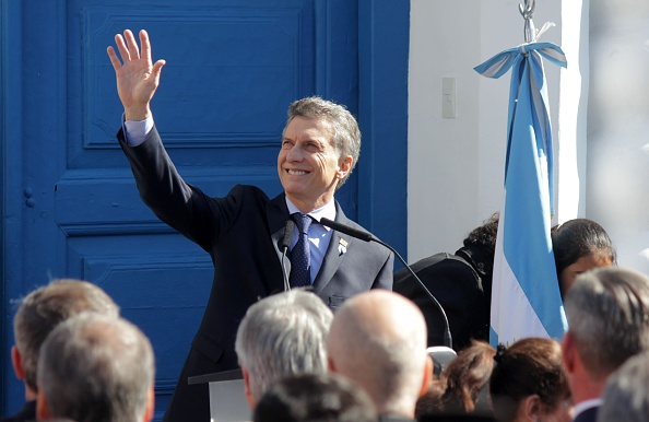 Argentinian President Mauricio Macri waves as he deliversa speech during the commemoration of the bicentenary of the Argentinian Independence in Tucuman, Argentina on July 9, 2016. / AFP / Walter Monteros (Photo credit should read WALTER MONTEROS/AFP/Getty Images)