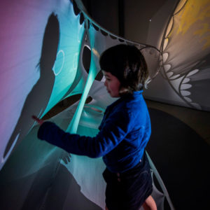 Ara, Sean Ahlquist's daughter, interacting with the Social Sensory Architecture pavilion. Courtesy Sean Ahlquist, University of Michigan.