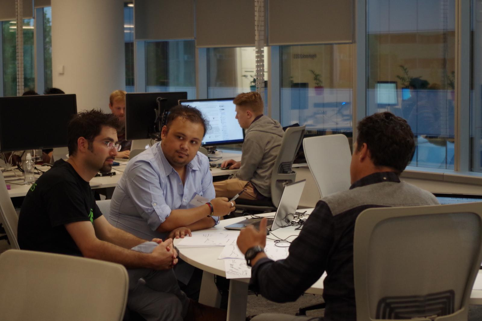 """><br /> <br /> <em>The ideas machine in action: while some concentrate on code, others debate the commercial strengths of their proposition.</em><br /> <br /> <strong>Heard on the hackathon floor</strong><br /> <br /> During the course of the Hackathon, the combined voices on Level 3 in GE's light-filled North Sydney offices speak volumes about their thinking and where they're coming from:<br /> <br /> <em>""""I'm in robotics and mechatronics . I work for Woolworths... The Industrial Internet is starting to come into play there. Real-time availability of everybody's information will help people make more informed and more timely decisions."""" </em><br /> <br /> —Dr Michael Lucas, designer, engineer<br /> <br /> <em>""""We four just finished university together. We all did engineering, at the University of Sydney. This was kind of the last project we'd do as a team, as a group of friends."""" </em><br /> <br /> —Anirban Ghose, graduate<br /> <br /> <em>""""I have a product-development business. This is what I do for a living. But I came just for a bit of fun. Sure, I do it all the time, but I work with customers, and this gives me a sense of what the development community is doing."""" </em><br /> <br /> —Ran Peleg, founder, Visionware Solutions<br /> <br /> <em>""""I like what GE is doing with industry data—it's not just for GE, it can be applied almost everywhere."""" </em><br /> <br /> —Gary Weng, director of development, SENTIBIT<br /> <br /> <em>""""I study medicine at the University of Sydney. I'm always interested in what GE does. I know GE does a lot of medical equipment, so I came here and ended up working on a project that's not related!"""" </em><br /> <br /> —Po Liu, software developer and medical student<br /> <br /> <em>""""I've got strengths in commercialisation, in software development and user experience but I'm not an engineer, so the big challenge I found was taking my approach and adapting it to the engineers. The engineers are very detailed, they're more expansive and I'm more """