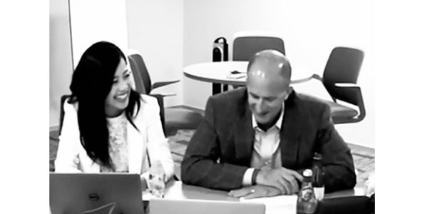 Joanne Woo and John Rice during an employee webcast